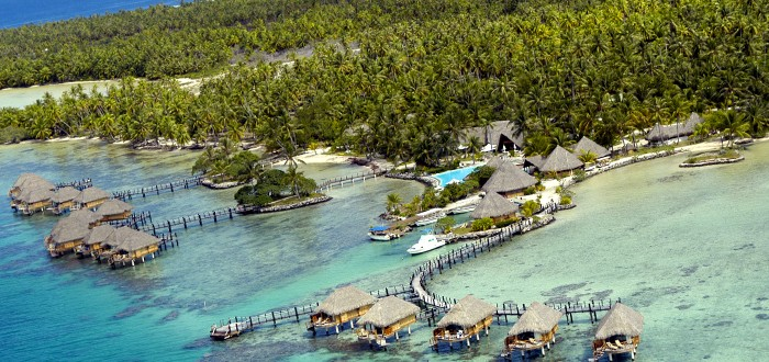 Overwater bungalows on Manihi Lagoon